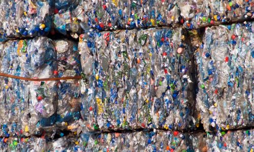 Compacted recyclable plastic waste at a recycling plant.