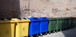 three type of plastic big trash recycling bins on the street