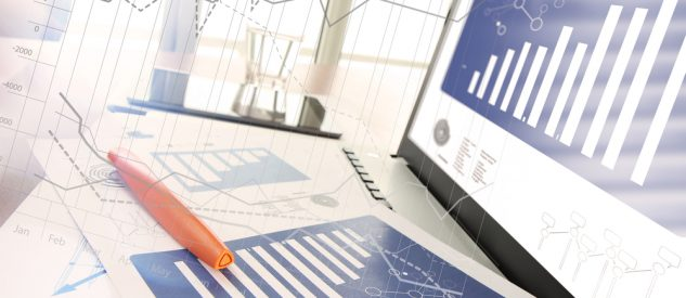 business documents on office table with smart phone and digital tablet and modern pen with laptop computer in workspace concept