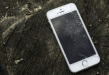 Broken white iphone glass on wood