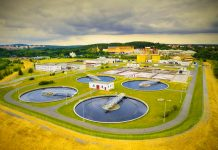 Aerial view of public sewage treatment plant for 165, 000 inhabitants of Pilsen city in Czech Republic, Europe. Environment and industry from above.
