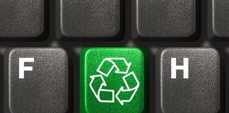 Computer keyboard with recycling symbol, technology concept