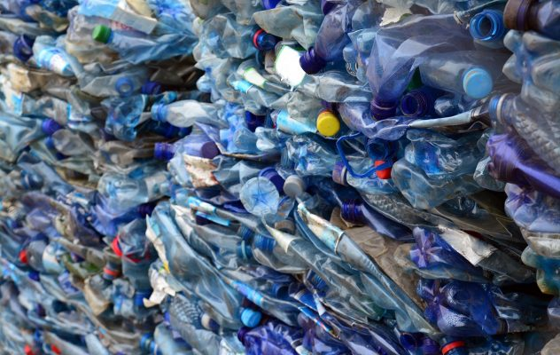 pile of plastic bottles prepared for recycling